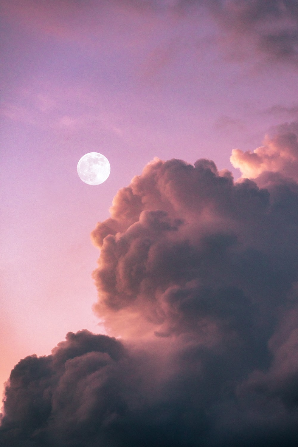full moon over clouds during night time
