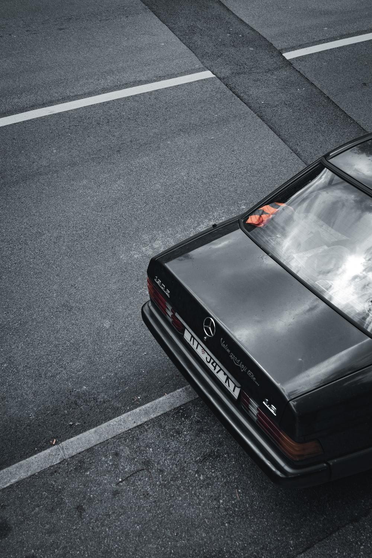black car on gray asphalt road