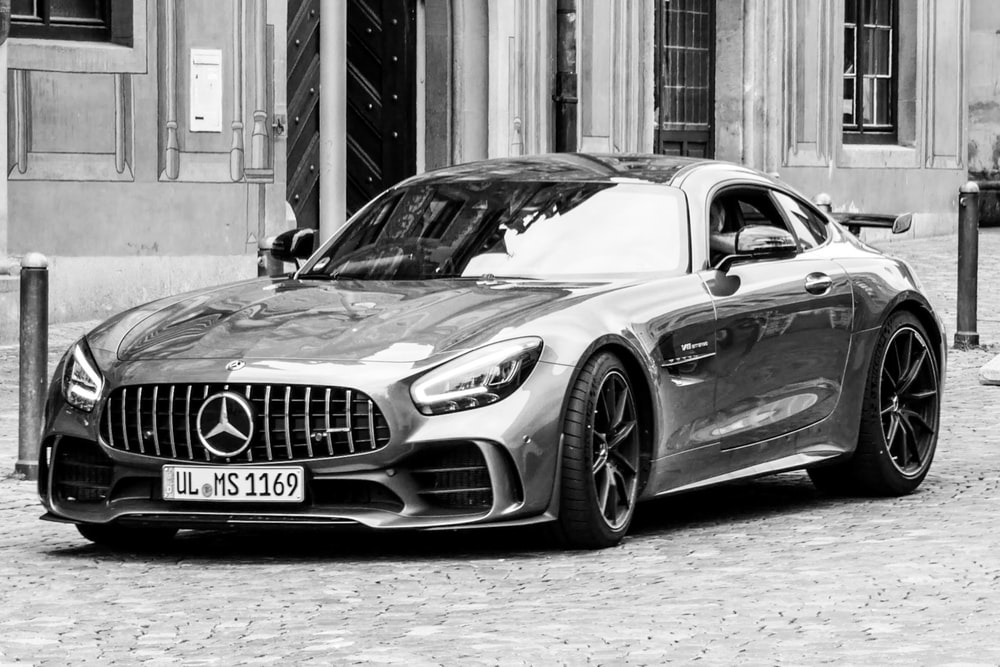 grayscale photo of mercedes benz coupe