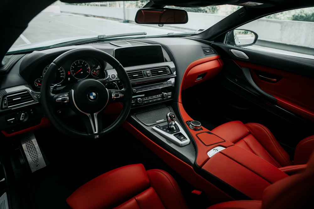 red and black mercedes benz steering wheel