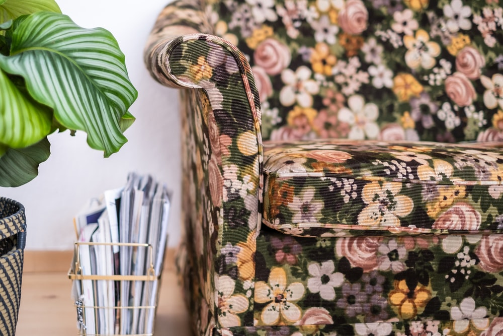 brown and green floral armchair