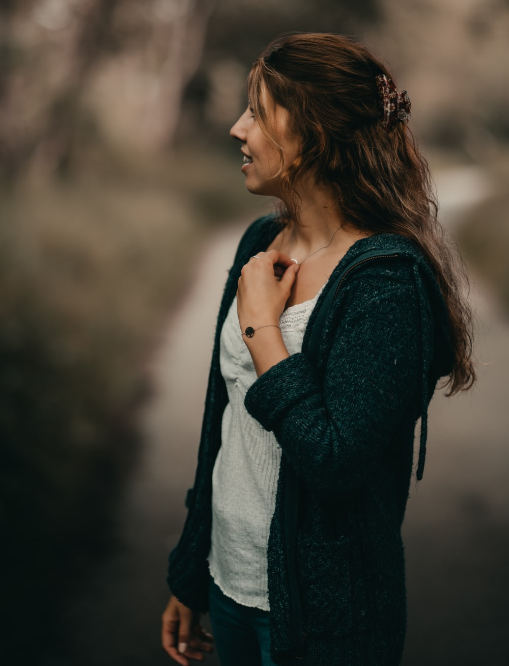 woman in black cardigan and white shirt