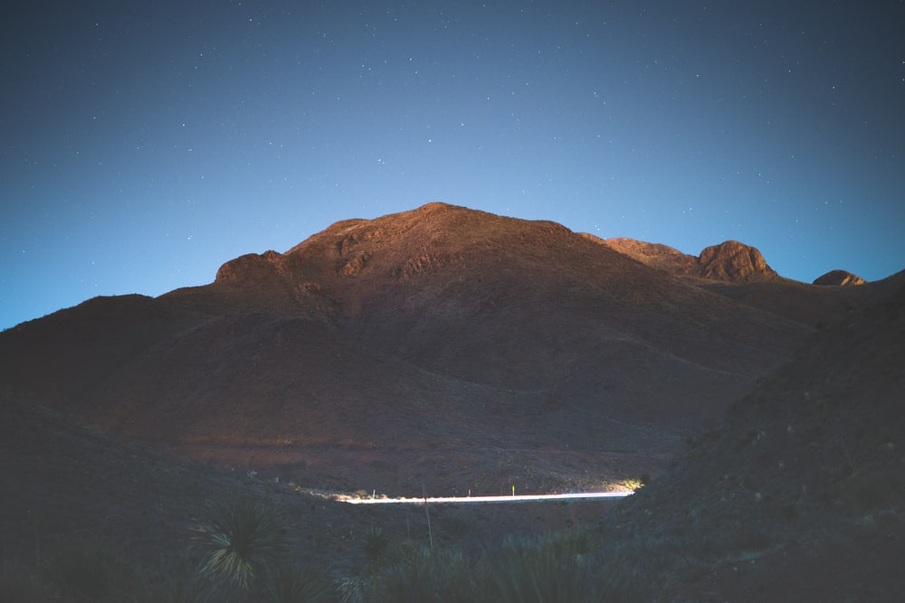 brown mountain under blue sky during night time
