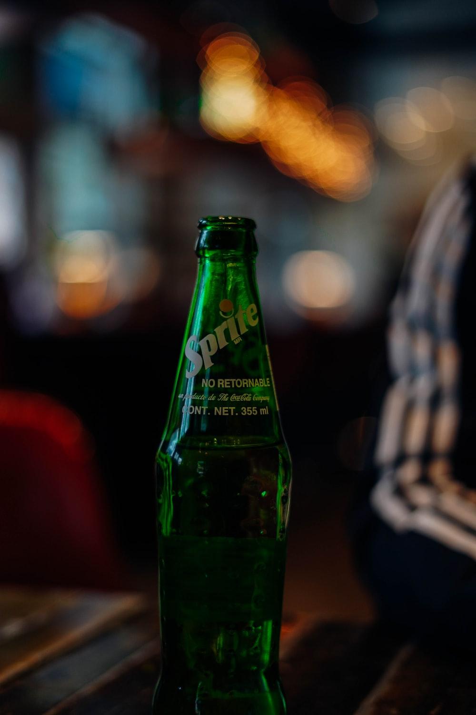 green sprite bottle in bokeh photography