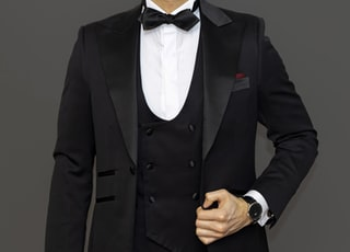 man in black suit jacket and black dress pants