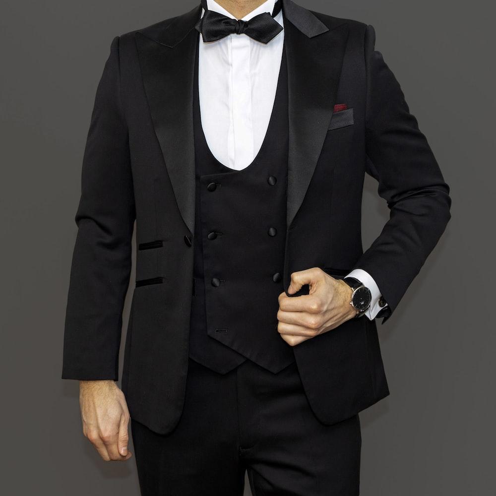 man in black suit jacket and black dress pants