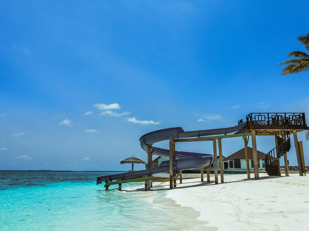 Outdoor Natural Gas Fire Pit Table, Brown Wooden Beach Lounge Chairs On Beach During Daytime Photo Free Water Image On Unsplash