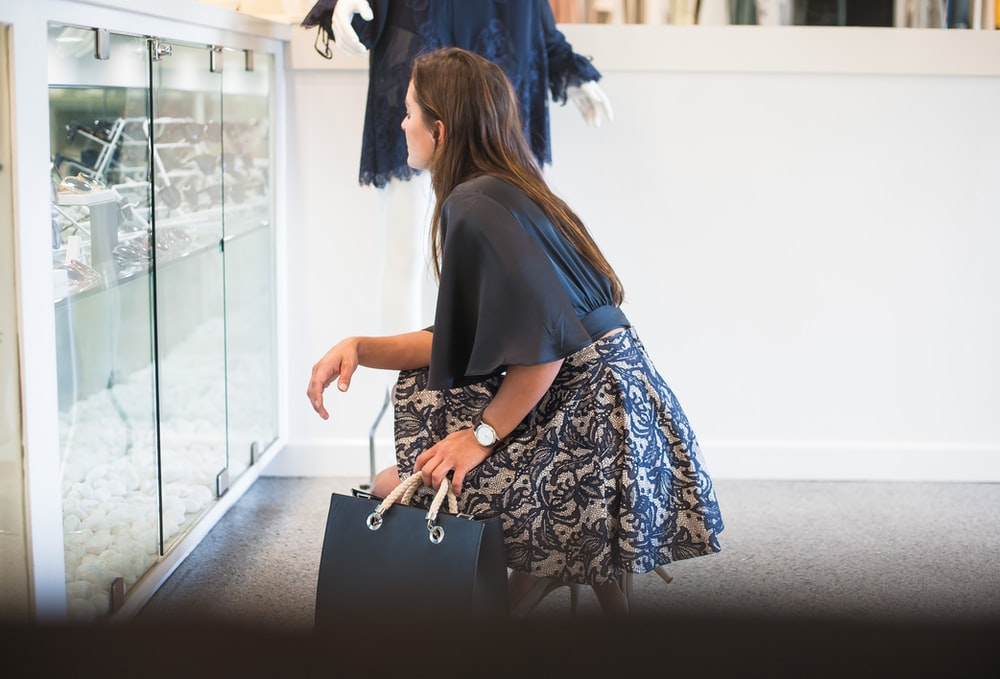 woman in black long sleeve shirt and blue and white skirt