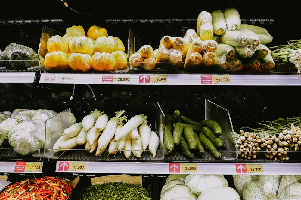 yellow and green vegetables on white shelf