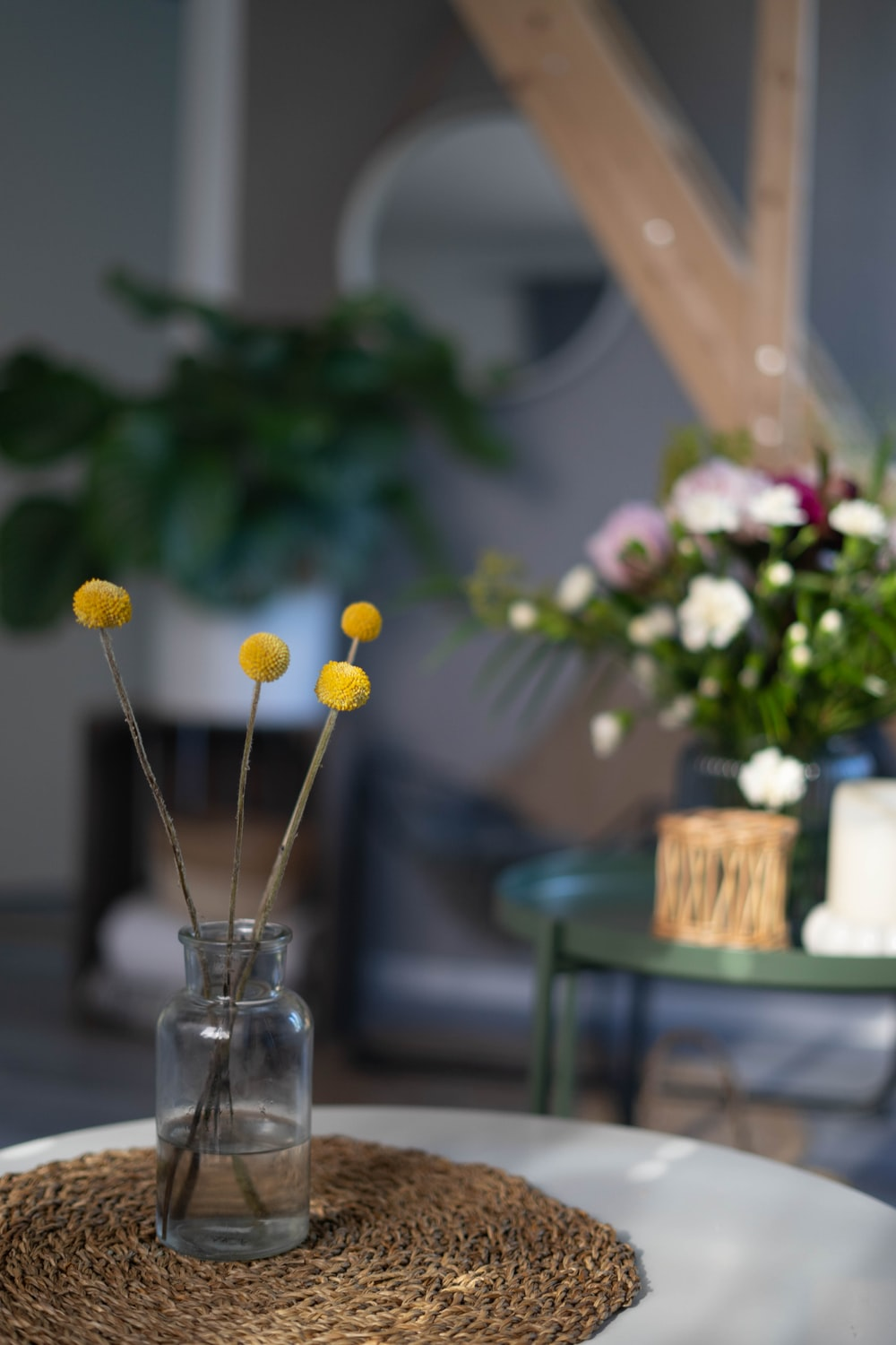yellow and white flowers in clear glass vase