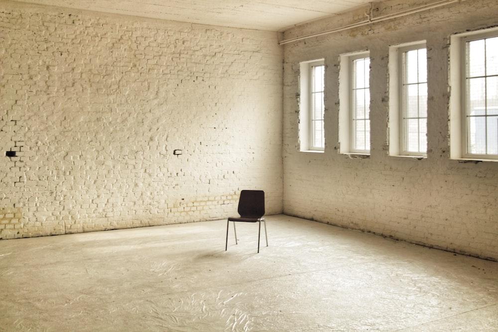 black chair beside brown wall