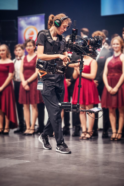 man in black t-shirt singing on stage