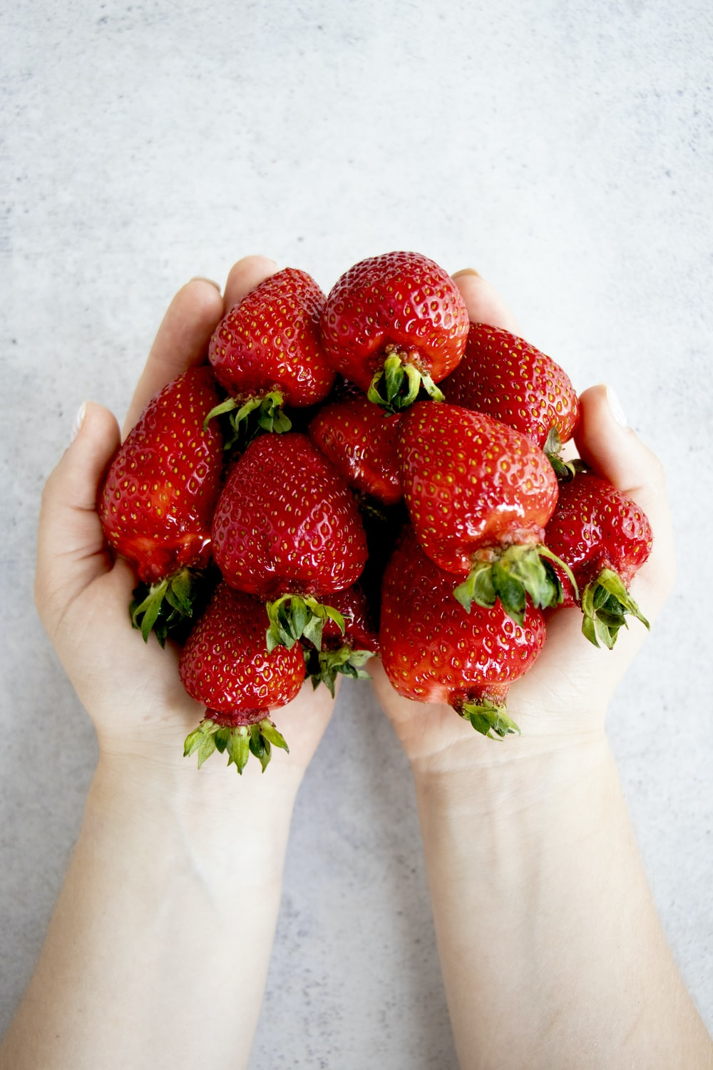 strawberries on persons hand