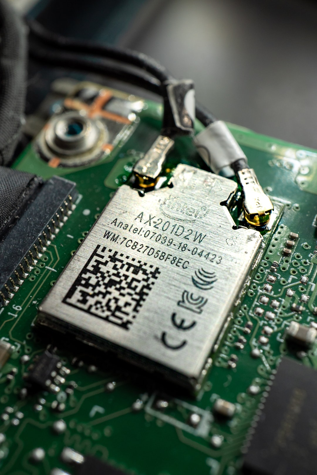 A WiFi 6 card, soldered onto a mainboard of a sleek ultrabook. This chip is produced by Intel and sports 2.4 as well as 5 GHz antennas.
