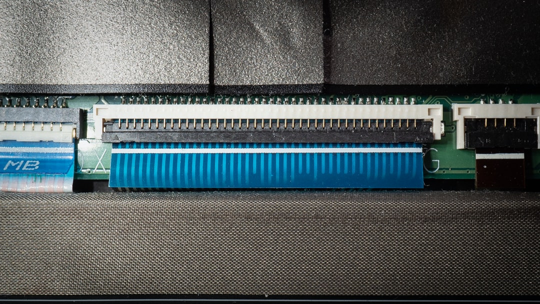 A huge ribbon cable, used for connecting electrical components almost everywhere. This one is in a laptop, connecting the Mainboard with additional components.