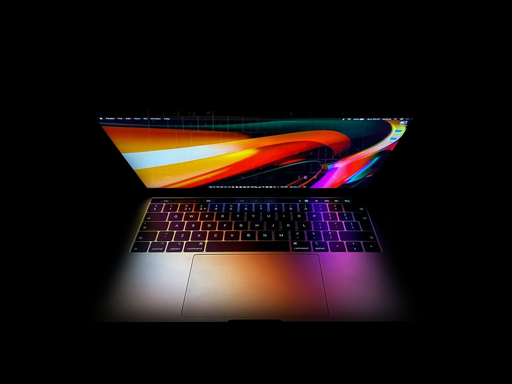 macbook pro turned on displaying red blue and yellow lights