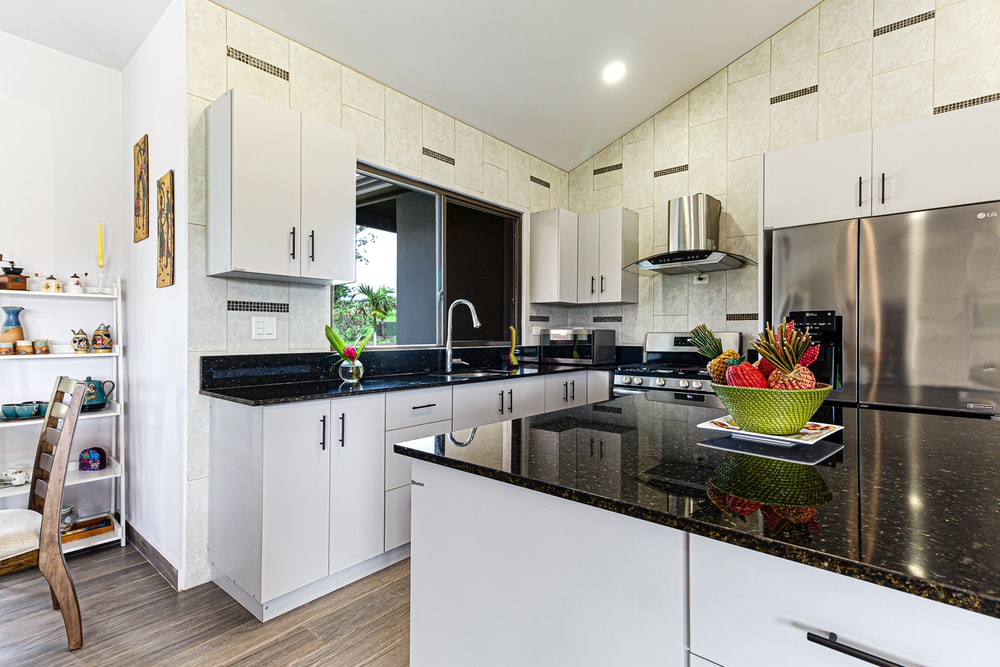 white wooden kitchen cabinet and sink