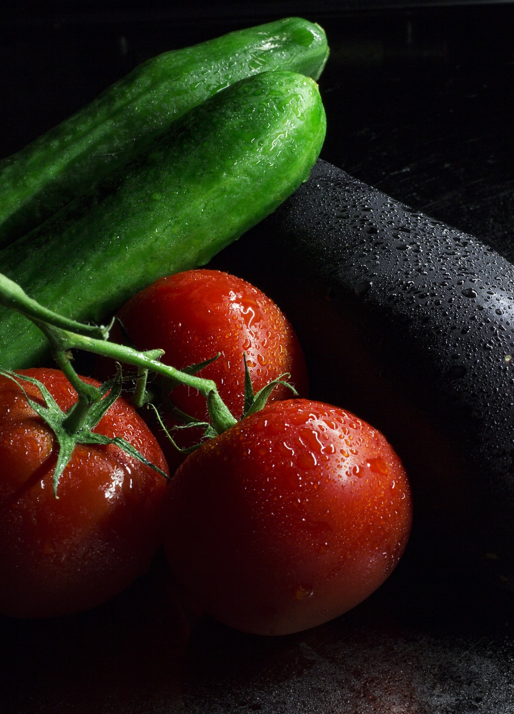 red tomato beside green cucumber