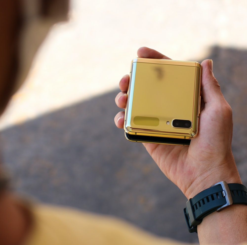 person holding gold iphone 6