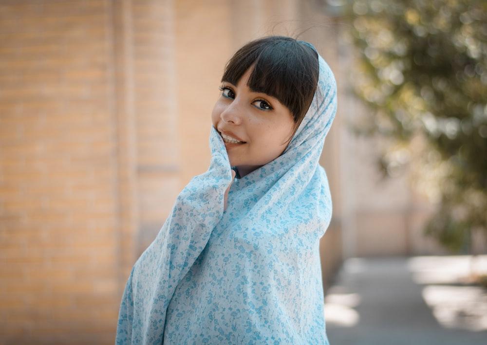 girl in blue hoodie standing