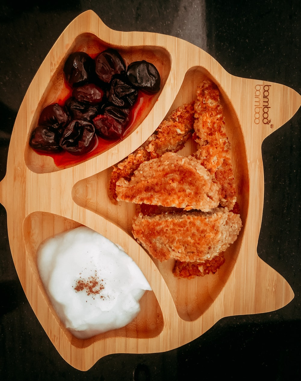 brown bread with white cream on brown wooden chopping board