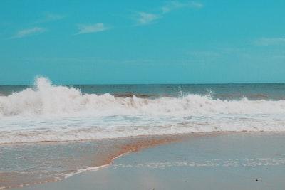 ocean waves crashing on shore during daytime delaware zoom background