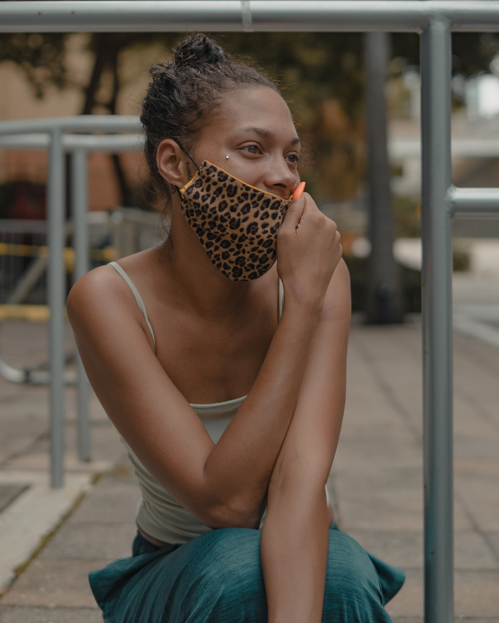 woman in blue tank top holding brown and black leopard print textile
