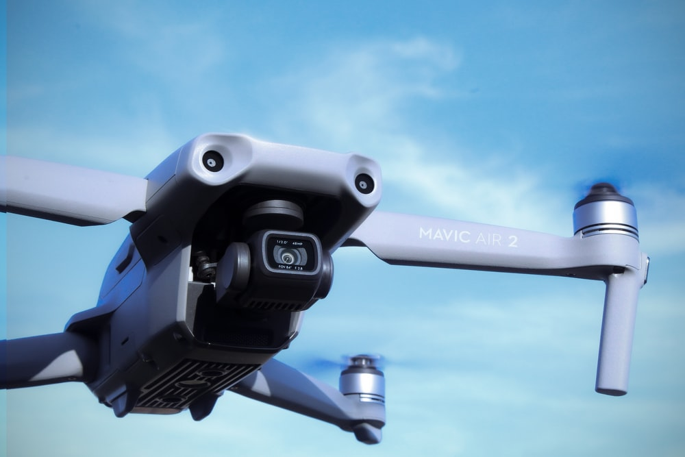 black and gray drone under blue sky during daytime