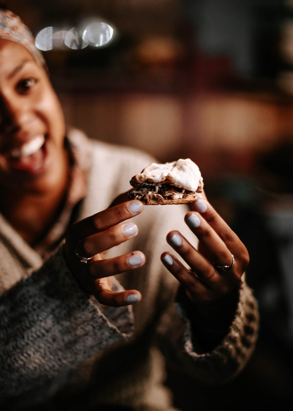 person holding brown and white ice cream