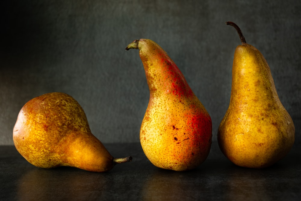 3 yellow and red fruits