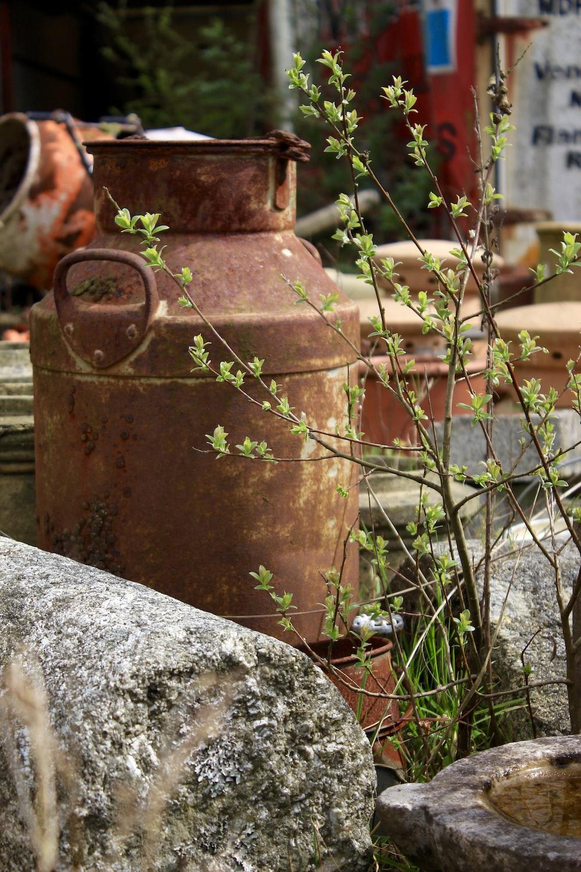 brown metal tank on gray concrete floor