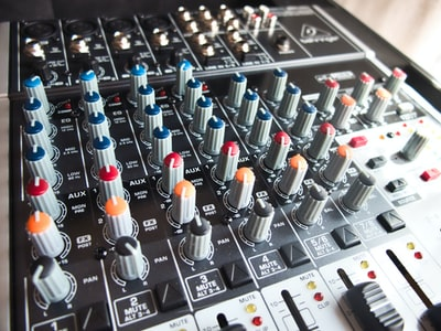 audio mixer with red and blue lights and buttons