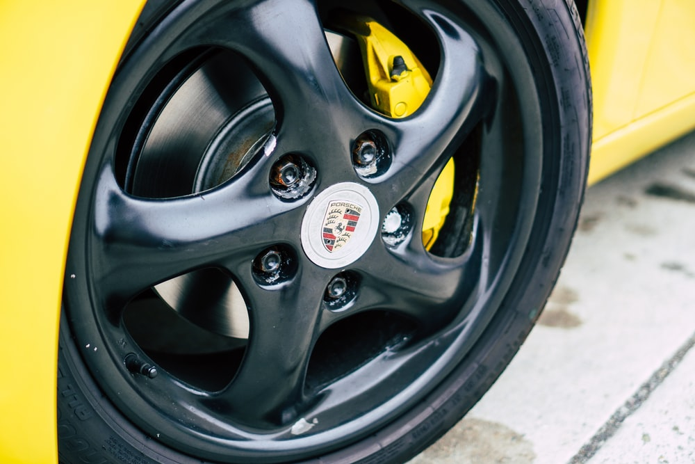black and yellow car wheel