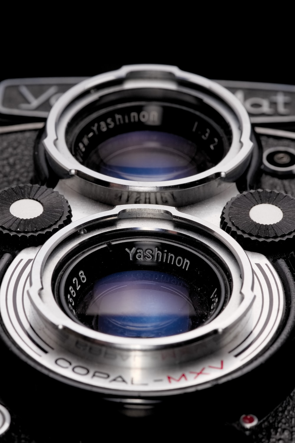 black and silver dslr camera lens