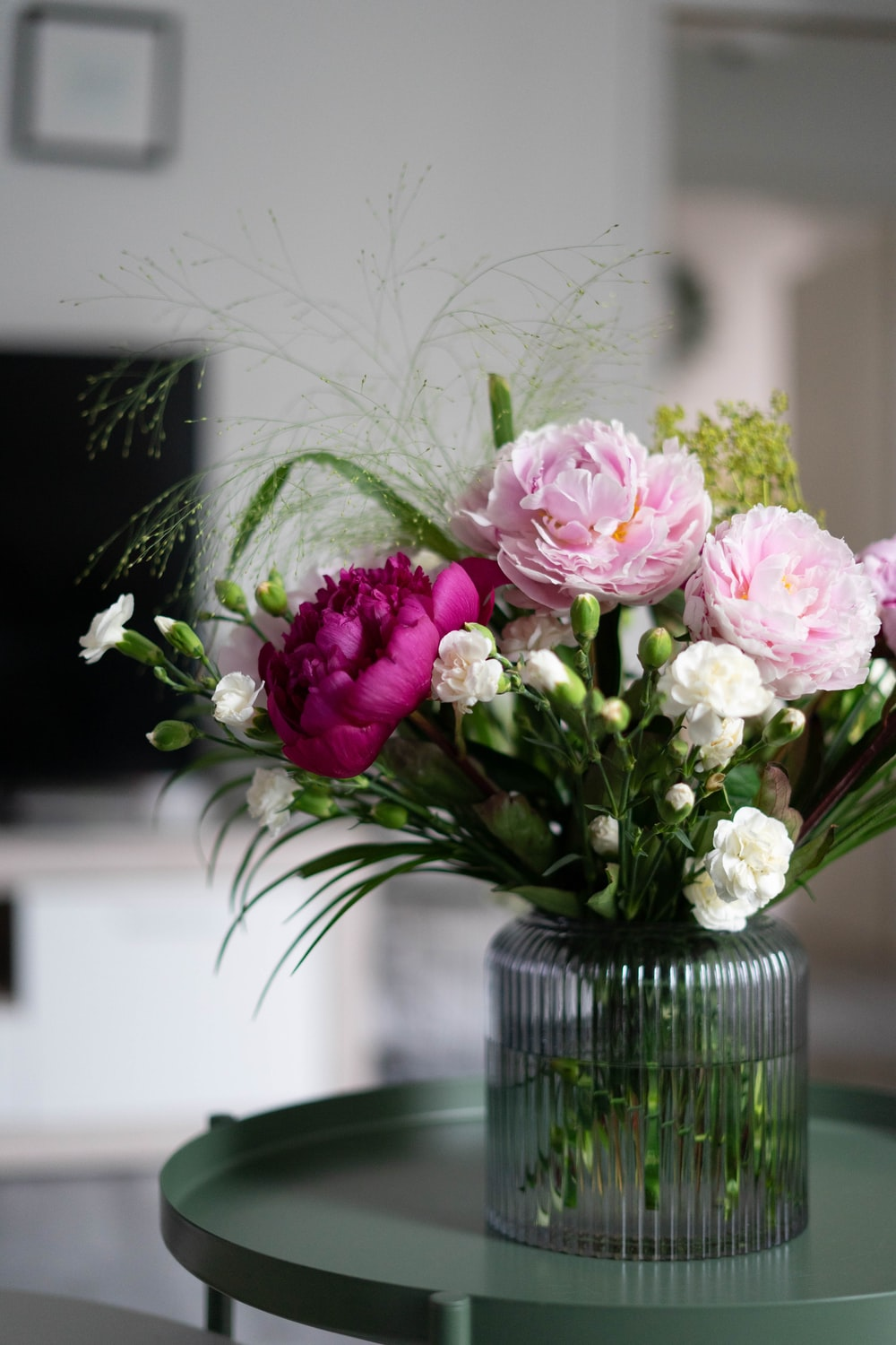 pink and white flowers in clear glass vase