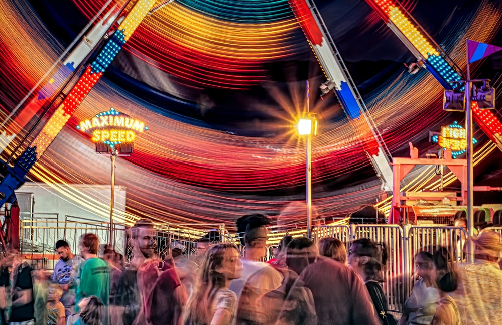 people in a carousel during night time