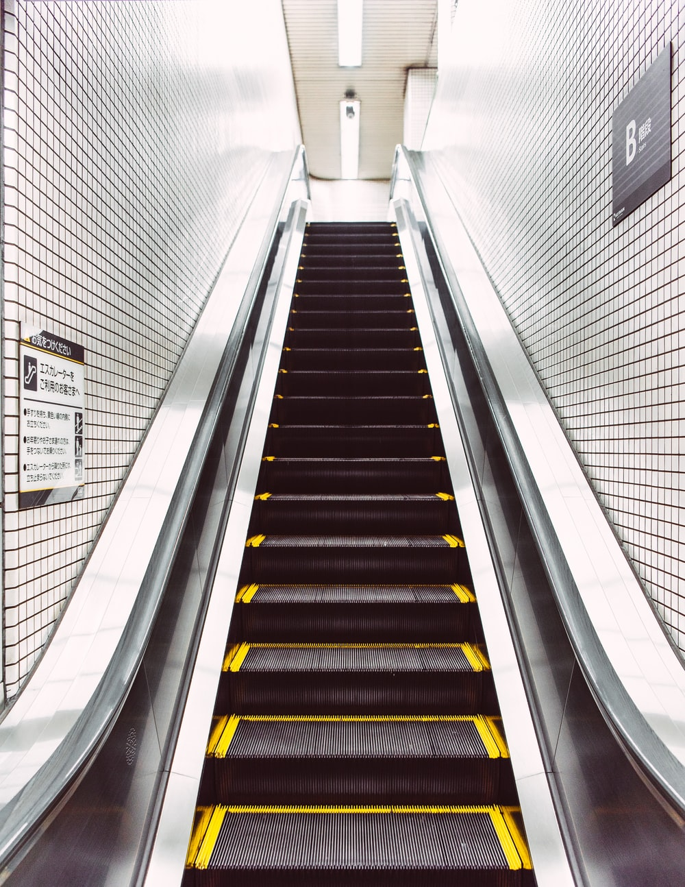 black and white escalator with no people