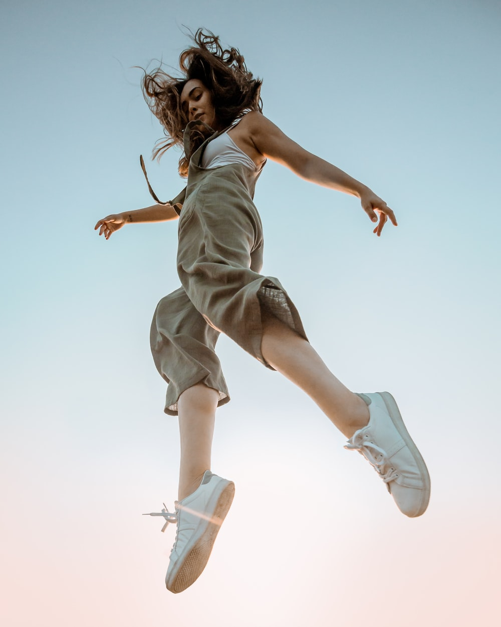 woman in white dress jumping
