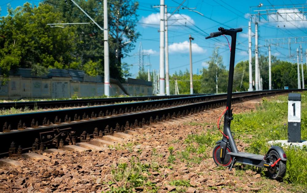black metal train rail during daytime