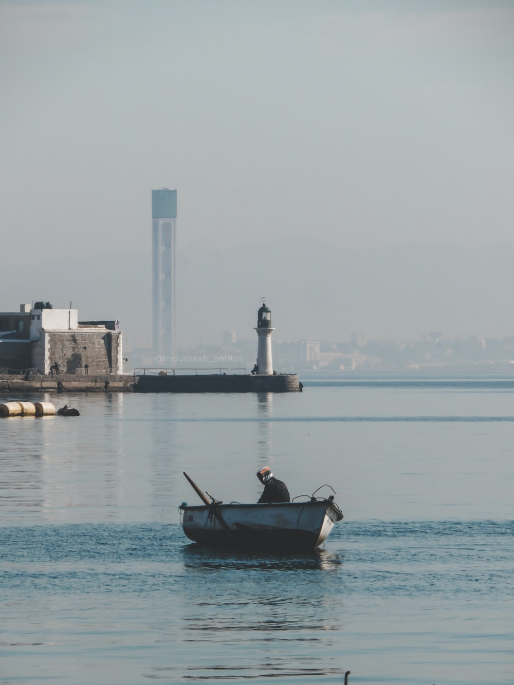 man in black shirt riding on boat during daytime