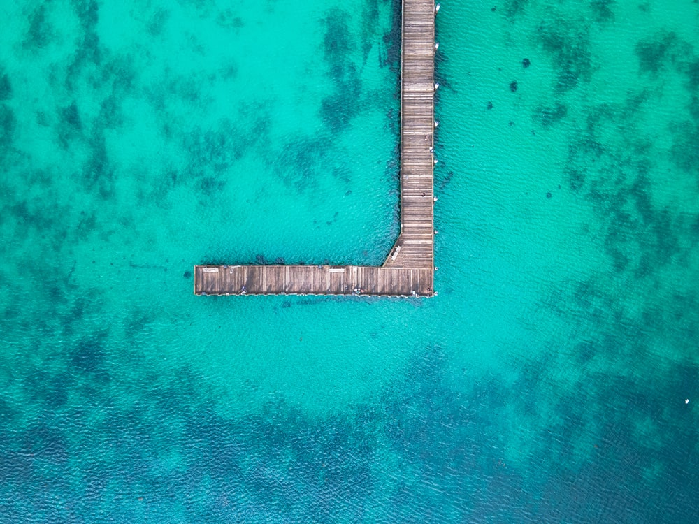 aerial view of brown wooden dock on body of water