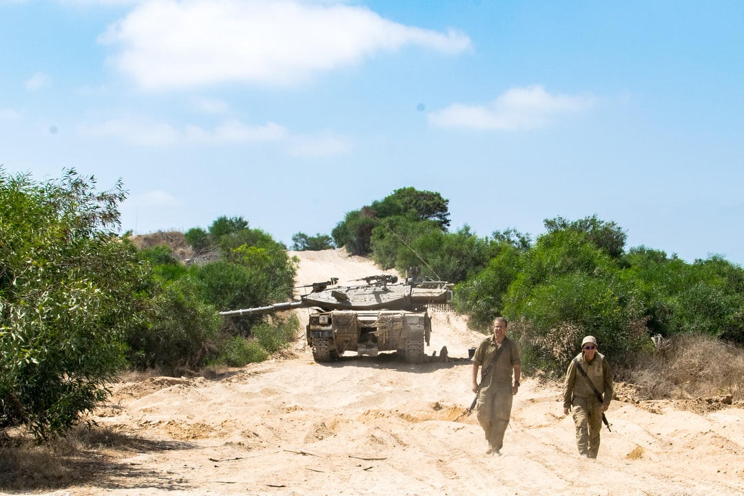 A shot captured of two Israeli soldiers coming to greet us as we were capturing the moment for routine surveillance of regions along Israel's borders. They are the two soldiers who are working on and with the tank pictured here as well.