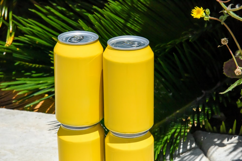 yellow and silver can on white table