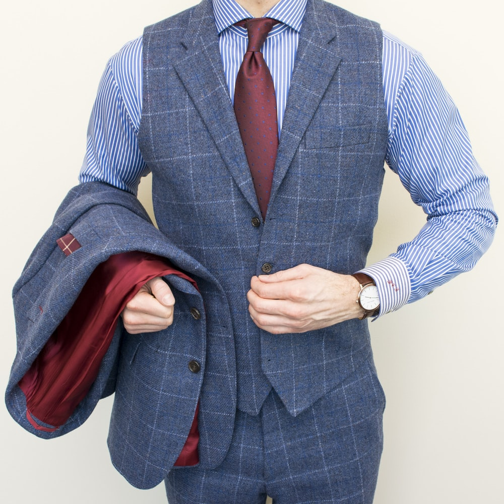man in blue and gray pinstripe suit jacket