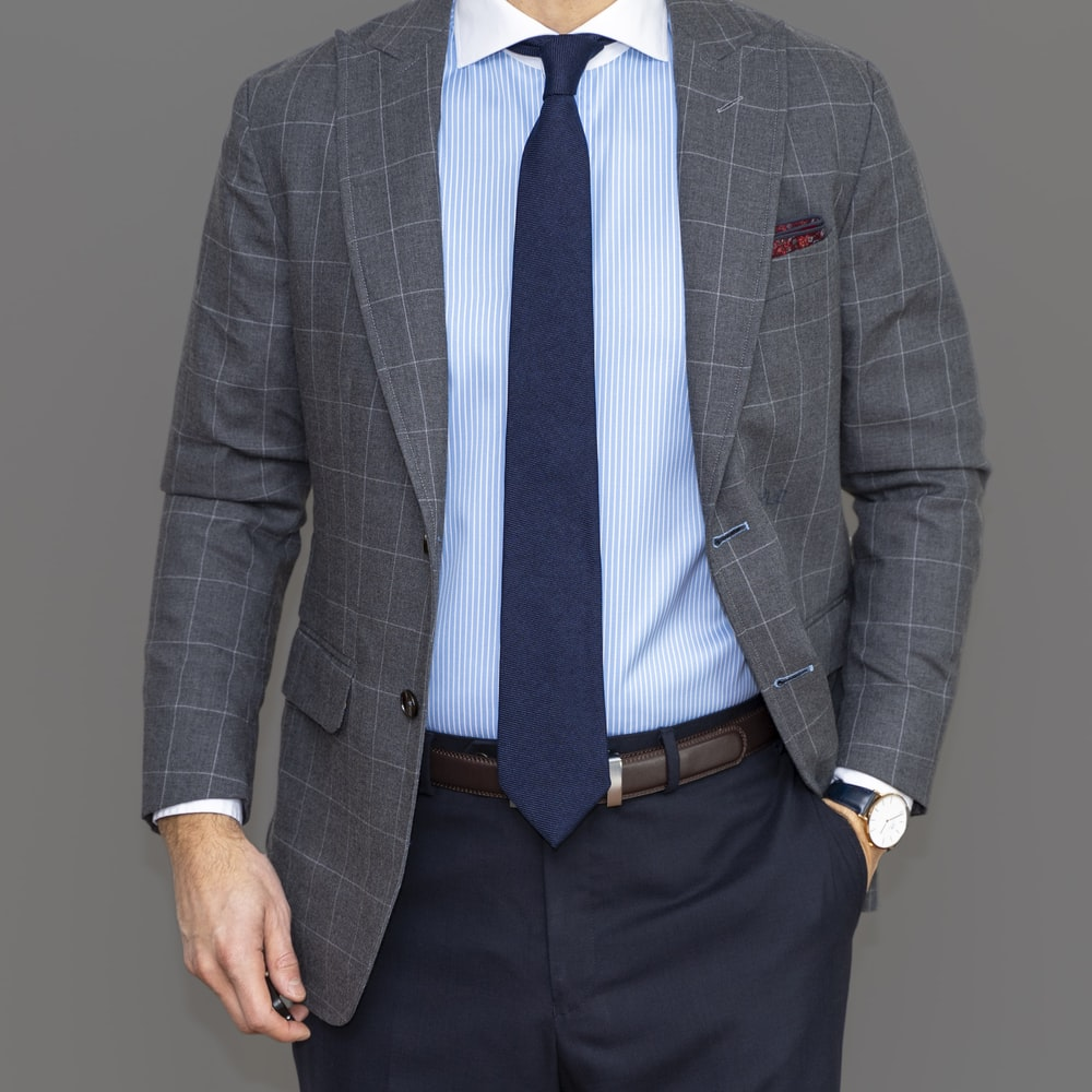 man in gray suit jacket and black dress pants