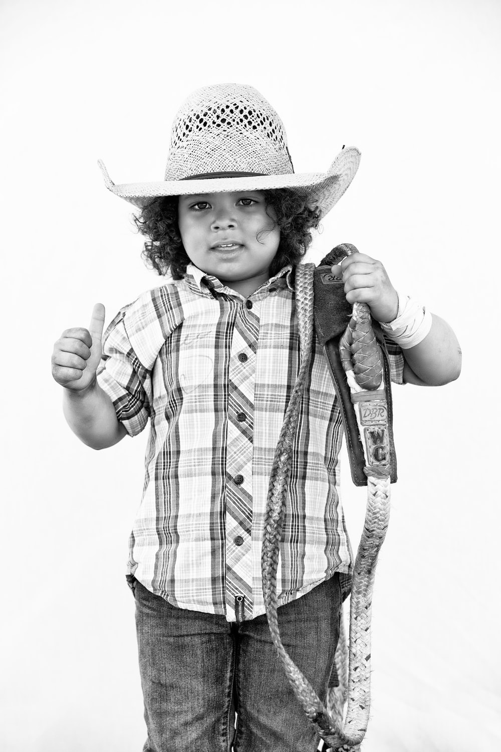 grayscale photo of boy wearing cowboy hat