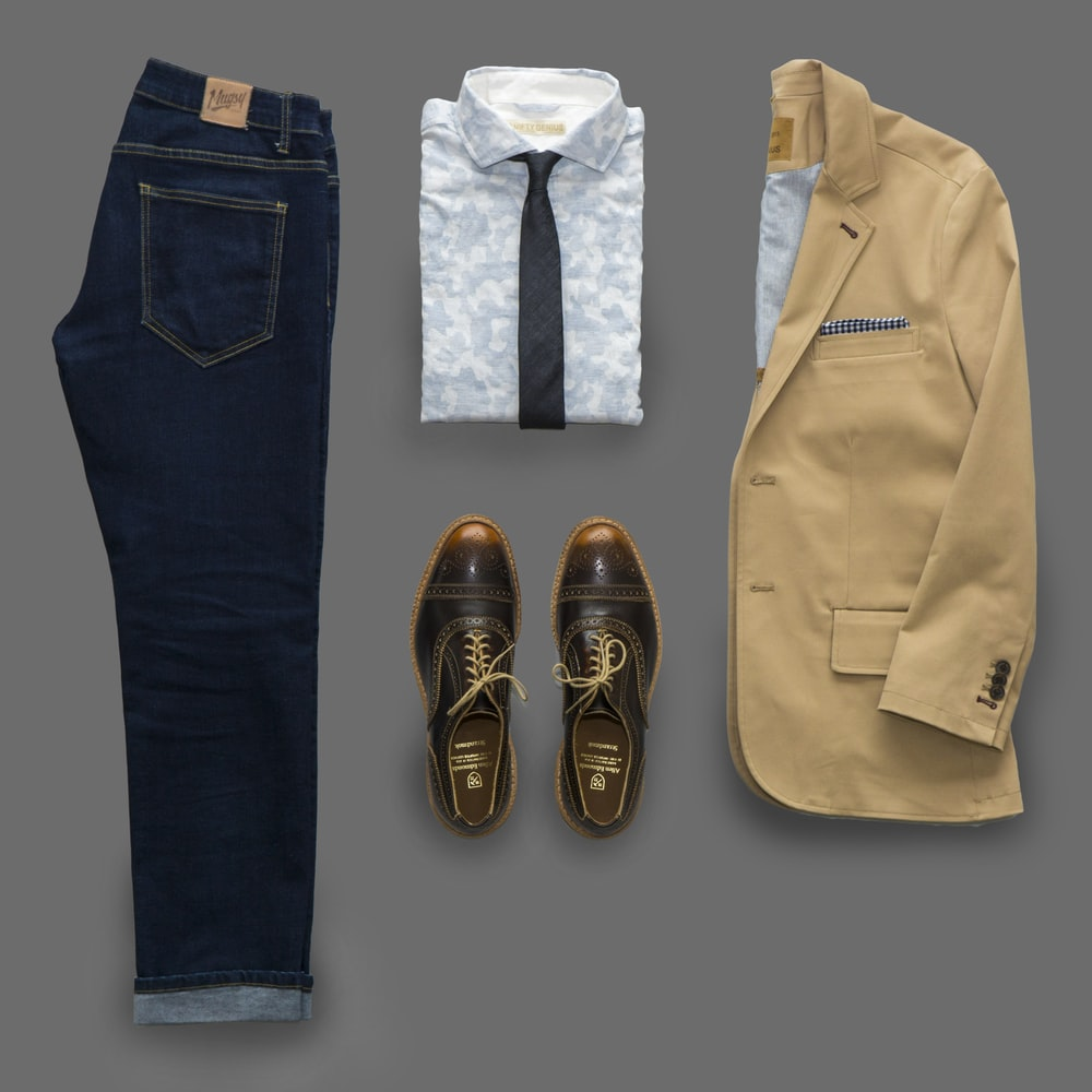 blue denim jeans and brown leather shoes