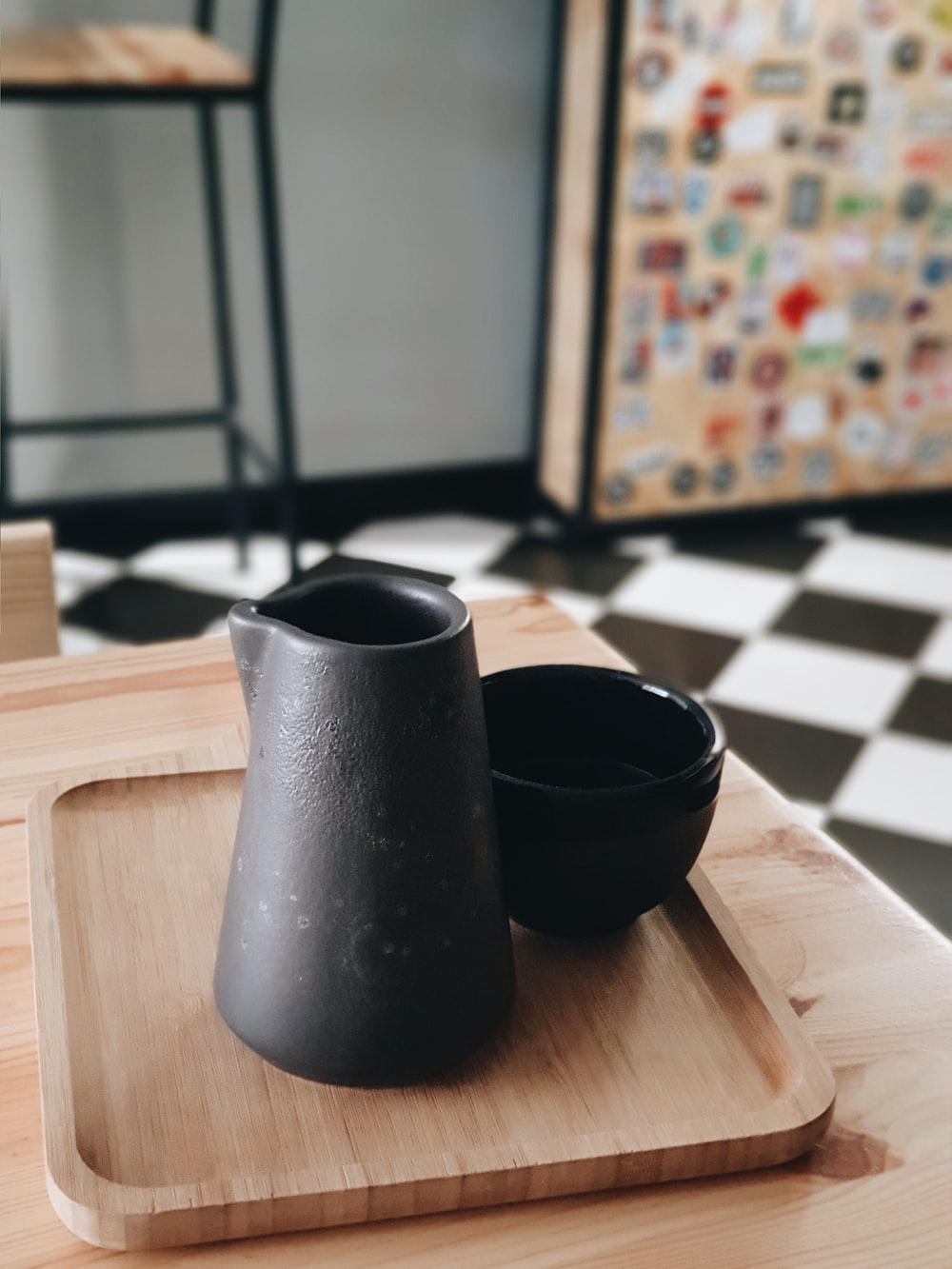 black pitcher on brown wooden table