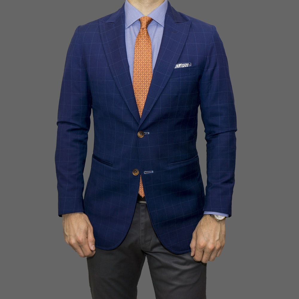 man in blue suit standing