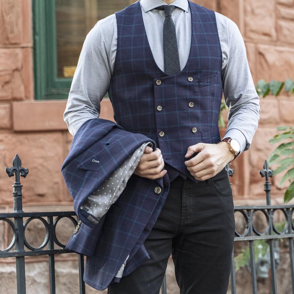 man in blue vest and blue dress shirt